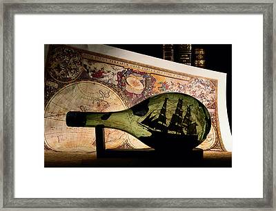 An Antique Map Provides The Backdrop Framed Print by Todd Gipstein