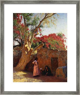 An Arab Family Outside A Village Framed Print by Ludwig Deutsch