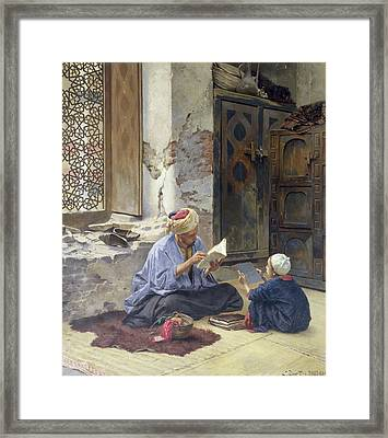 An Arab Schoolmaster Framed Print by Ludwig Deutsch