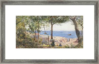 An Artist Painting By The Sea Framed Print