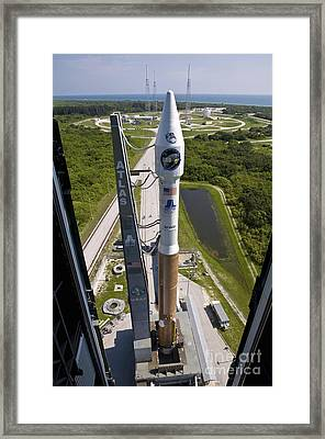 An Atlas V Rocket On The Launch Pad Framed Print by Stocktrek Images