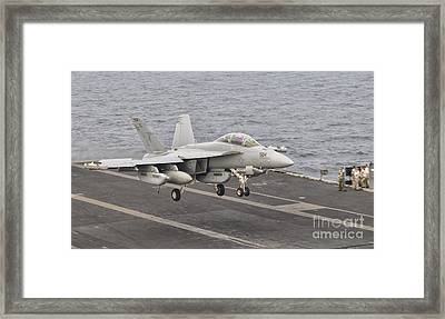 An Ea-18g Growler Landing On The Flight Framed Print by Giovanni Colla