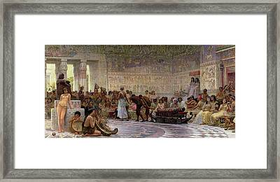An Egyptian Feast Framed Print by Edwin Longsden Long
