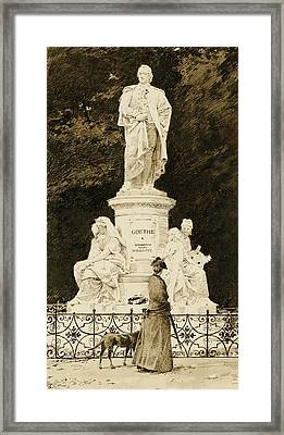 An Elegant Lady At The Statue Of Goethe Framed Print by Paul Fischer