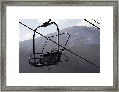 An Empty Chair Lift At A Ski Resort Framed Print by Tim Laman
