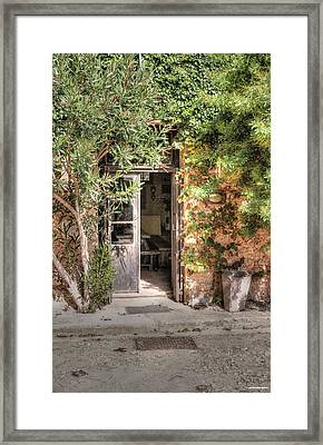 Framed Print featuring the photograph An Entrance In Santorini by Tom Prendergast