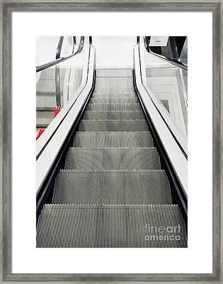 An Escalator Framed Print by Tom Gowanlock