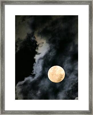 An Evil Face In The Clouds Framed Print