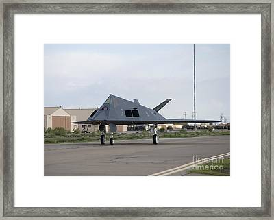An F-117 Nighthawk Taxis To The Runway Framed Print