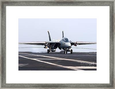An F-14d Tomcat Makes An Arrested Framed Print by Gert Kromhout