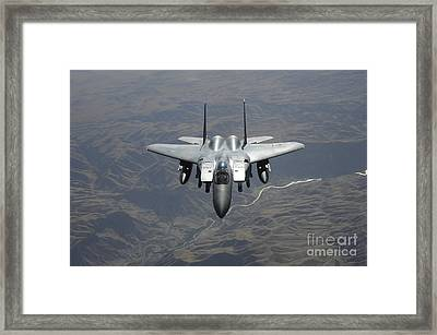 An F-15e Strike Eagle Flies Watch Framed Print by Stocktrek Images