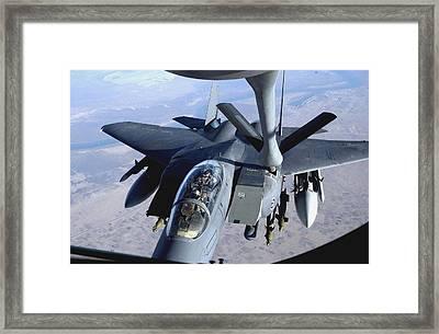 An F-15e Strike Eagle Refuels Over Iraq Framed Print