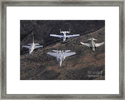 An F-16 Fighting Falcon, F-15 Eagle Framed Print by Stocktrek Images
