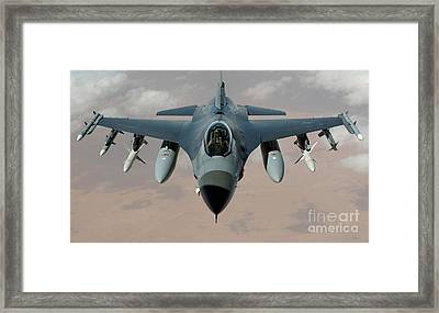 An F-16 Fighting Falcon Flies A Mission Framed Print by Stocktrek Images