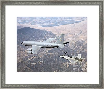 An F-22 Raptor Receives  Fuel Framed Print by Stocktrek Images