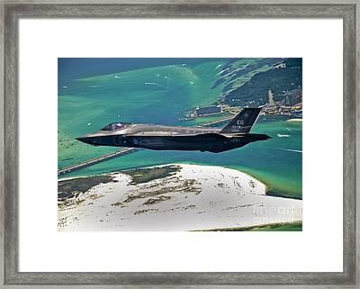An F-35 Lightning II Flies Over Destin Framed Print by Stocktrek Images
