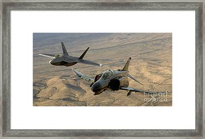 An F-4 Phantom And An F-22a Raptor Fly Framed Print by Stocktrek Images