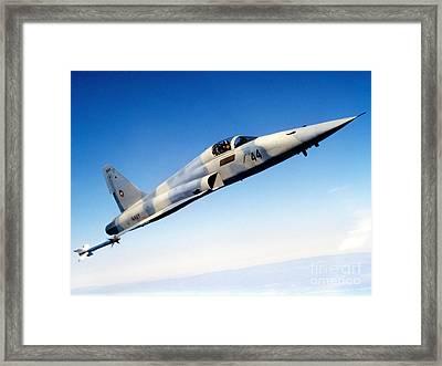 An F-5e Tiger II In Flight Framed Print by Dave Baranek