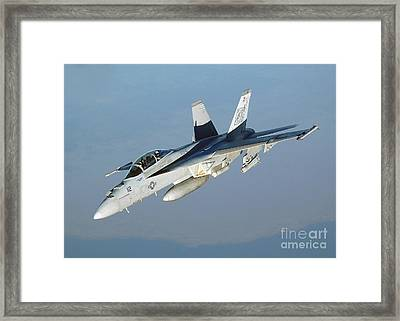 An Fa-18f Super Hornet Conducts Framed Print by Stocktrek Images