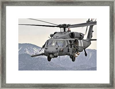 An Hh-60 Pave Hawk Helicopter In Flight Framed Print by Stocktrek Images