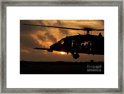 An Hh-60g Pave Hawk Helicopter Prepares Framed Print by Stocktrek Images