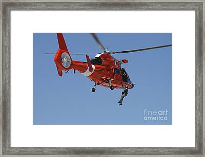 An Hh-65c Dolphin Demonstrates Framed Print