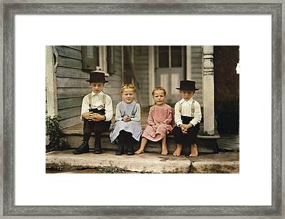 An Informal Group Portrait Of Amish Framed Print by J Baylor Roberts