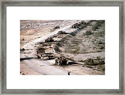 An Iraqi Armored Column Destroyed Framed Print by Everett