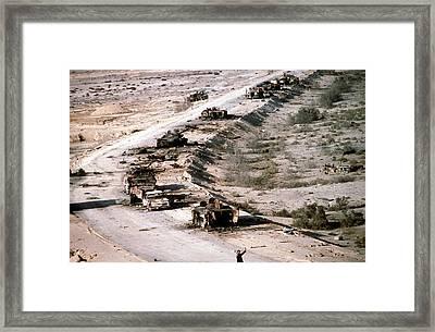 An Iraqi Armored Column Destroyed Framed Print by Everett