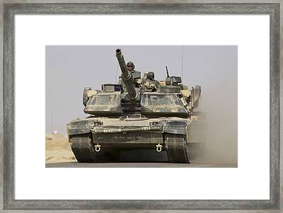 An M1a1 Abrams Tank Heading Framed Print by Stocktrek Images