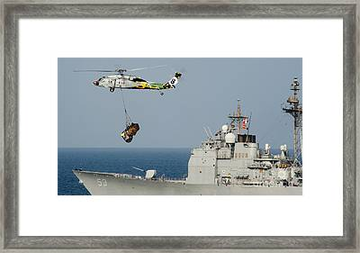 An Mh-60s Sea Hawk Helicopter Carries Pallets Framed Print