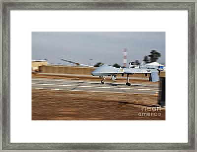 An Mq-1c Sky Warrior Uav Lands At Camp Framed Print