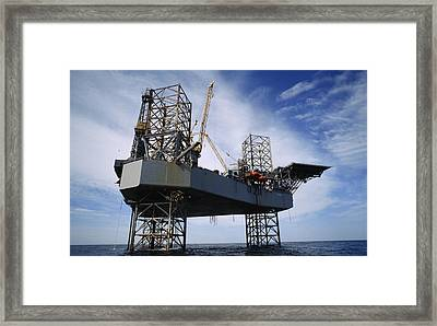 An Oil And Gas Drilling Platform Framed Print by Justin Guariglia
