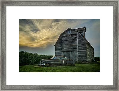 An Old Cadillac By A Barn And Cornfield Framed Print