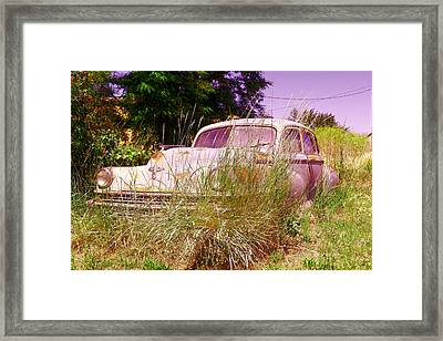 An Old Car Left In The Weeds Framed Print by Jeff Swan