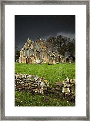 An Old Church Under A Dark Sky Framed Print