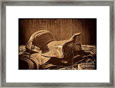 An Old Saddle Framed Print by American West Legend By Olivier Le Queinec