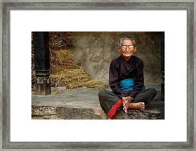 An Old Woman In Bhaktapur Framed Print by Valerie Rosen