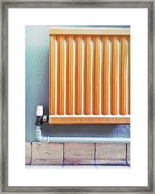 An Orange Radiator Framed Print