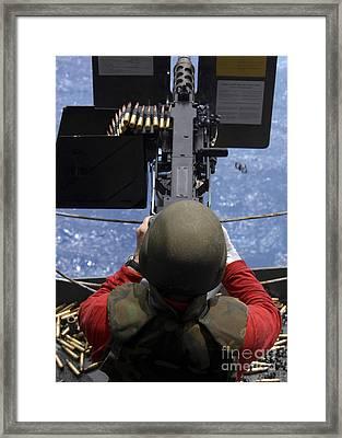 An Ordinance Handling Officer Shooting Framed Print by Stocktrek Images
