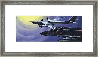 An Raf Phantom Of Strike Command Pulls In Close To A Russian Tupolev Tu95d  Framed Print by Wilf Hardy