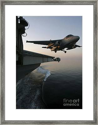 An S-3b Viking Clears The Flight Deck Framed Print