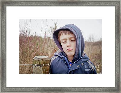 An Upset Child Framed Print by Tom Gowanlock