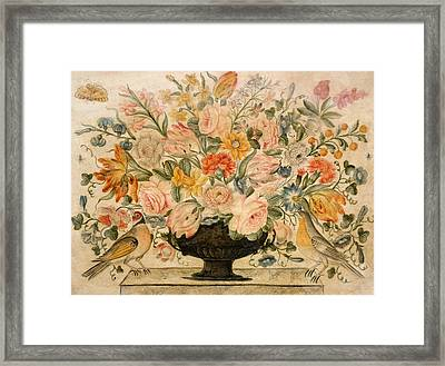 An Urn Containing Flowers On A Ledge Framed Print