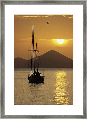 Anchored Ketch And Sunset Over Caribbean Framed Print by Don Kreuter