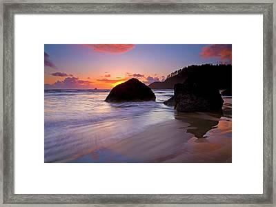 Anchoring The Beach Framed Print by Mike  Dawson