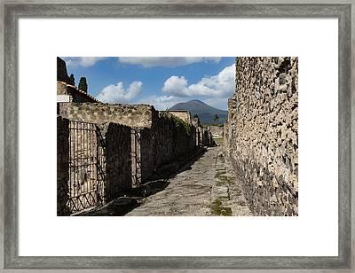 Ancient Pompeii - Empty Street And Mount Vesuvius Volcano That Caused It All Framed Print by Georgia Mizuleva