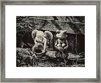 Angel And Frog Framed Print