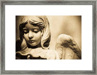 Angel Holding Clam Shell Framed Print by Diane Payne