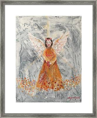 Angel In Orange Framed Print by Jun Jamosmos